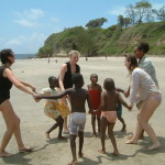 Children and some visiting English Medical Students on Pangani Beach