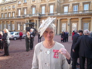 Karilyn outside Buckingham Palace after recieving the MBE for services to Palliative Medicine in Tanzania